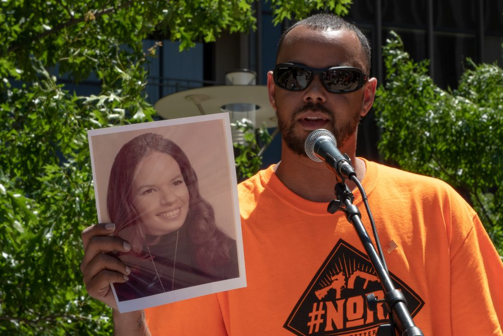 Khary Penebaker holds a photograph of his mother, Joyce, at a protest of the NRA convention in Dallas, Texas, on May 5, 2018. (Courtesy of NoRA)