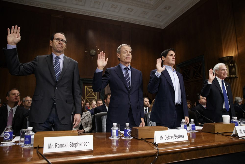 From left, AT&T Chairman and CEO Randall Stephenson, Time Warner Chairman and CEO Jeffrey Bewkes, AXS TV Chairman and Dallas Mavericks owner Mark Cuban, and Public Knowledge Chairman and CEO Gene Kimmelan are sworn in  on Capitol Hill in Washington, Wednesday, Dec. 7, 2016,, prior to testifying before a Senate Judiciary subcommittee hearing on the proposed merger between AT&T and Time Warner. (AP Photo/Evan Vucci)