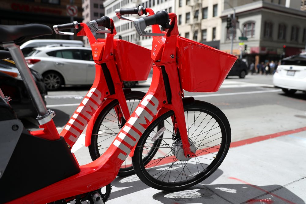 Jump bikes sit parked on a street corner in San Francisco. (Justin Sullivan/Getty Images)