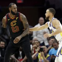 Cleveland Cavaliers' LeBron James is defended by Golden State Warriors' Stephen Curry during the first half of Game 4 of basketball's NBA Finals, Friday, June 8, 2018, in Cleveland. (Tony Dejak/AP)