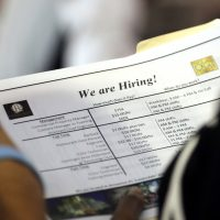 In this Thursday, June 21, 2018 photo, a job applicant looks at job listings for the Riverside Hotel at a job fair hosted by Job News South Florida, in Sunrise, Fla. The Labor Department said Friday, July 6, that the unemployment rate rose to 4.0 percent from 3.8 percent as more people began looking for work and not all of them found it. (Lynne Sladky/AP)
