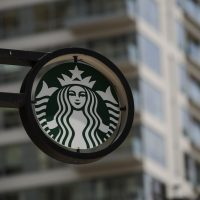 The Starbucks logo is seen outside a store in Philadelphia. (Kena Betancur/AFP/Getty Images)