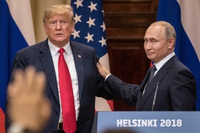 President Trump (left) and Russian President Vladimir Putin shake hands during a joint press conference after their summit on July 16, 2018 in Helsinki, Finland. (Chris McGrath/Getty Images)