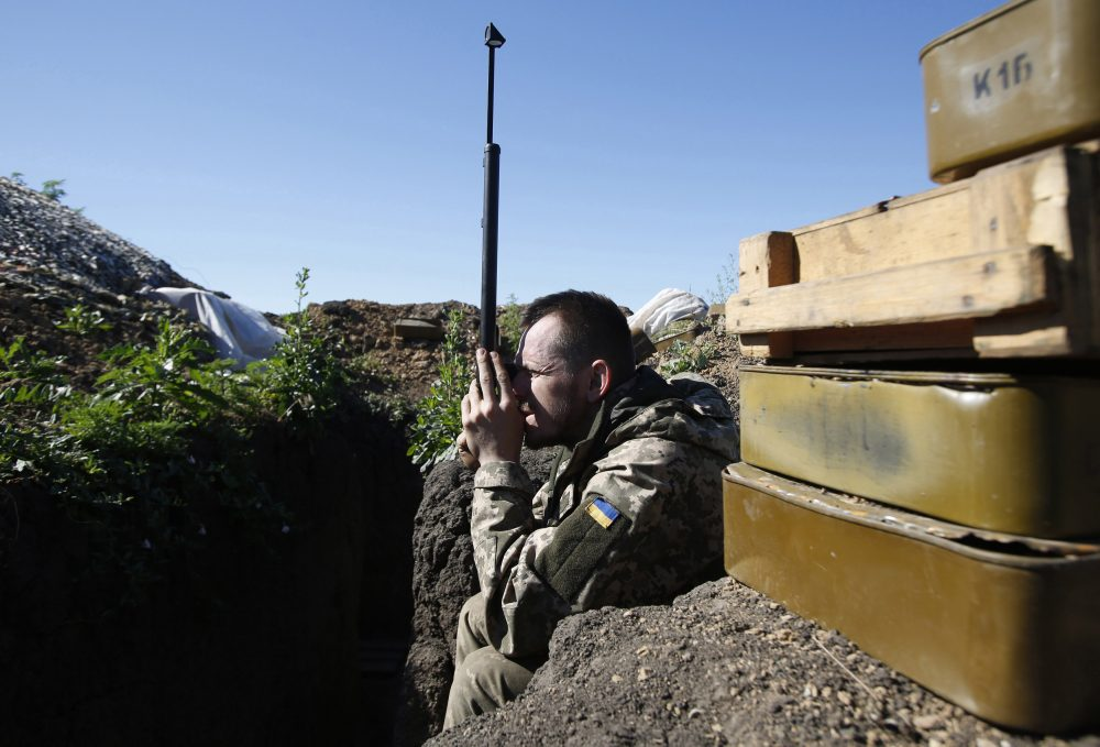A Ukrainian service member monitors the positions of Russia-backed separatists on the front-line near the southeastern city of Mariupol on June 11, 2018. (Anatolii Stepanov/AFP/Getty Images)
