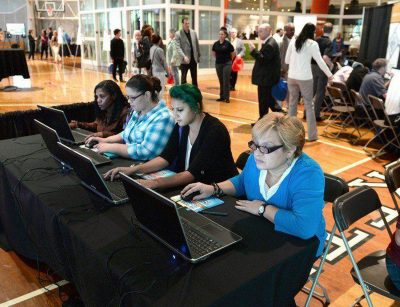 People looking to get a job at MGM Springfield use the computer to match their skills to potential jobs, during a career fair in October 2014. (Mark M. Murray/The Republican/MassLive.com)