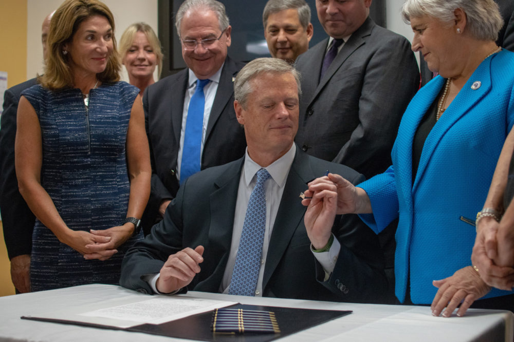 Opioid law is a blueprint for the nation gov baker says at gov charlie baker handed a ceremonial pen to state rep denise garlick co malvernweather Gallery