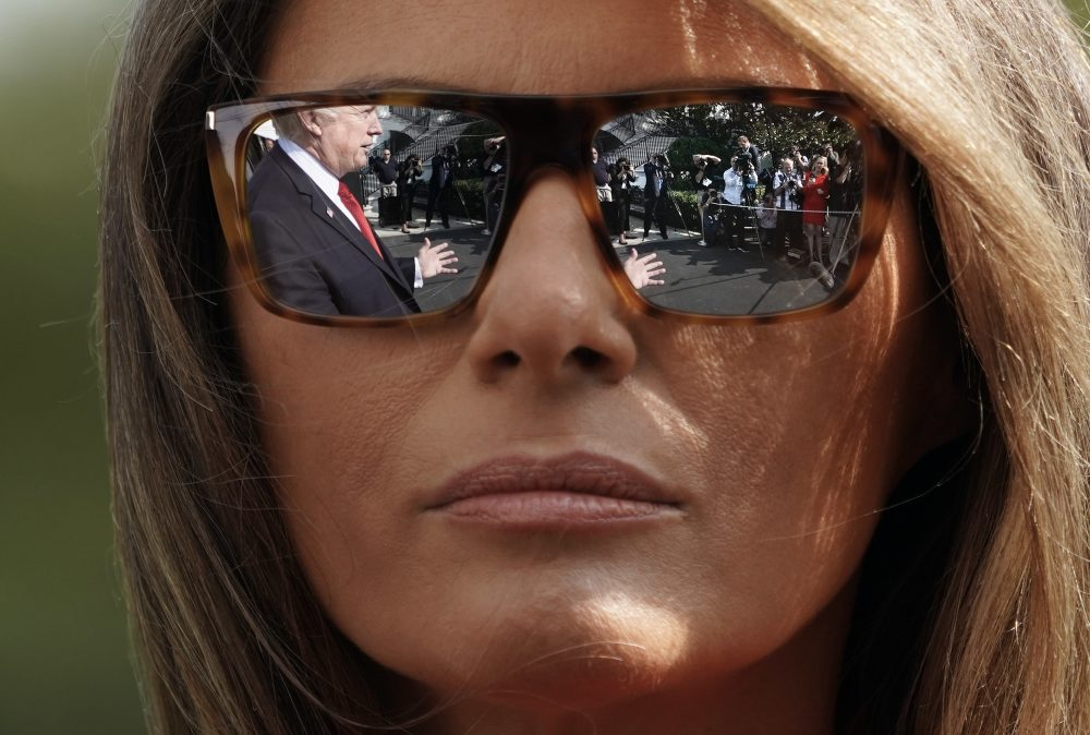 President Donald Trump's reflections are seen in the first lady Melania Trump's sunglasses as the president stops to answers questions on at South Lawn of the White House in Washington, Sunday, Sept. 10, 2017. (Pablo Martinez Monsivais/AP)