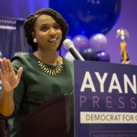 Ayanna Pressley addresses supporters celebrating her primary win. (Robin Lubbock/WBUR)