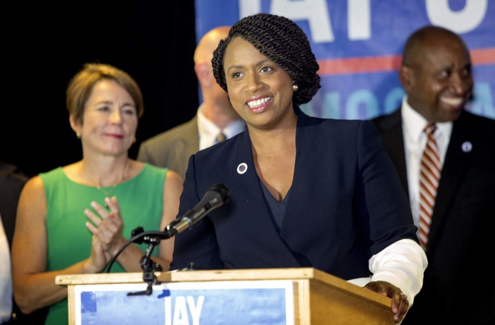 Ayanna Pressley at a Massachusetts Democratic Party Unity event in Dorchester. Attorney General Maura Healey, one of Pressley's most prominent supporters in her race this year, stands behind her. (Robin Lubbock/WBUR)