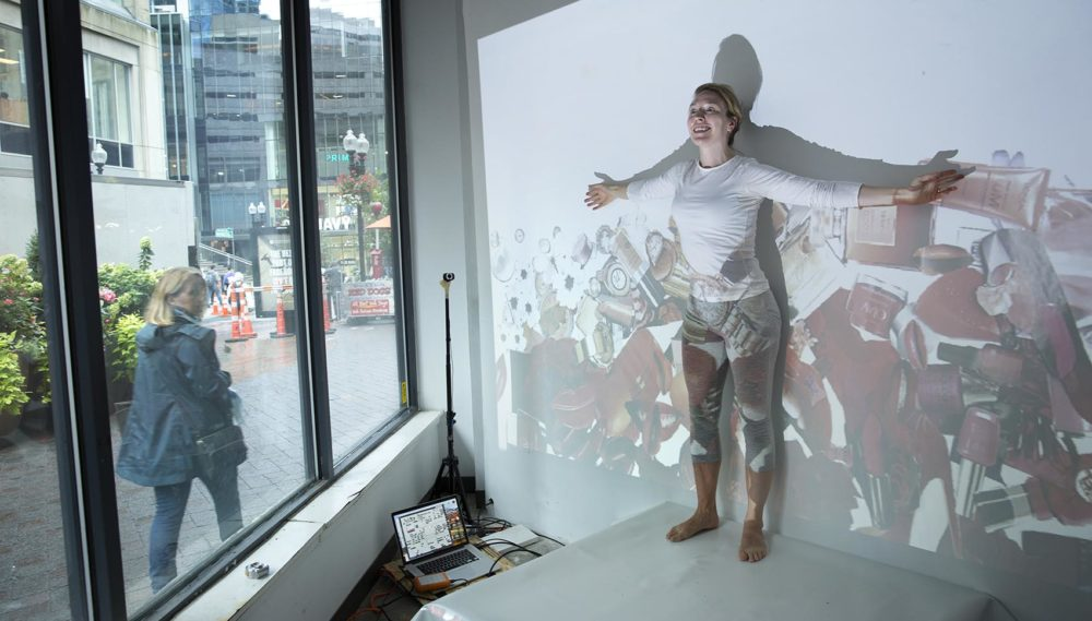 "Artist Catherine Siller rehearses ""Are You Buying?"" (Robin Lubbock/WBUR)"