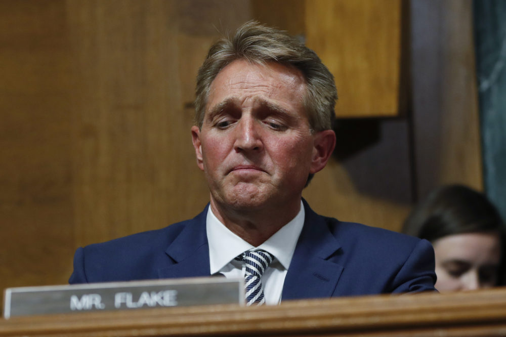 Sen. Jeff Flake R-Ariz. after speaking during the Senate Judiciary Committee hearing about an investigation Friday Sept. 28 2018 on Capitol Hill in Washington. After a flurry of last-minute negotiations the Senate Judiciary Committee advanced Brett