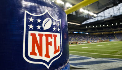 NFL Logo is seen on the goal post padding before an NFL preseason football game between the Detroit Lions and the New York Jets at Ford Field in Detroit, Thursday, Aug. 13, 2015. (AP Photo/Rick Osentoski)