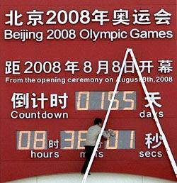 A Chinese worker cleans the Beijing Olympic countdown digital clock on display outside the national museum near the Tiananmen Square in Beijing, China, Thursday, March 6, 2008.  (AP Photo/Andy Wong)