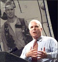 Sen. John McCain speaks in Leesville, S.C., on Sept. 28, 1999, in front of a portrait of himself during his days as a fighter pilot in Vietnam.