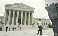 Security guards stand on the steps of the Supreme Court. (AP)