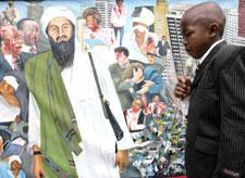 Victor Juma, who lost his father, stands in front of an artist's impression of the events of the 1998 U.S. embassy bombing at the memorial for the victims in Nairobi, Kenya, Aug. 7, 2008.