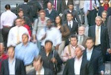 People walk to work on Wall Street last week. (AP)