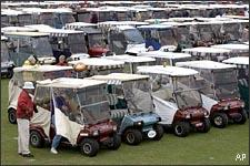 Patrons of The Villages Gridiron Classic, in The Villages, Fla., in January 2005. The game is held inside a retirement community, drawing large numbers of attendees who travel to the game by golf cart. (AP)