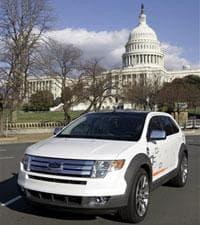 A Ford plug-in hybrid Edge cruises on Capitol Hill, Jan. 17, 2007. (AP)