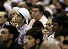 Worshippers listen to the Khutba during Friday Prayer at the 43rd annual Islamic Society of North America convention Friday, Sept, 1, 2006 in Rosemont, Ill. (AP Photo/M. Spencer Green)