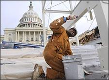 A worker paints the center stand of the inaugural platform at the west front of the Capitol on Dec. 4, 2008. (AP)