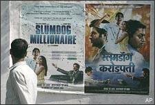"""A man walks past a poster of """"Slumdog Millionaire,"""" posted on a wall in Mumbai, India, Tuesday, Jan. 13, 2009. India's movie-mad millions have not yet seen """"Slumdog Millionaire,"""" but this Mumbai-based fairy tale, which opens here next week, is already the toast of Bollywood. (AP)"""