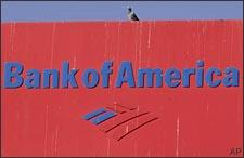 A pigeon sits atop Bank of America branch sign in Los Angeles on Friday, Jan. 16, 2009. (AP)