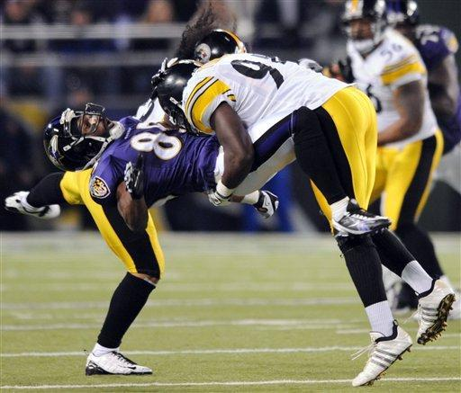 Baltimore Ravens wide receiver Derrick Mason is hit by Pittsburgh Steelers linebacker Lawrence Timmons. AP Photo.