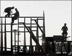 Workers are seen on the frame of a building under construction in Folsom, Calif., on Jan. 13, 2009. (AP)