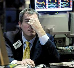 On the floor of the New York Stock Exchange, Monday, Feb. 23, 2009. The Dow Jones industrial average tumbled 251 points on Monday to its lowest close since Oct. 28, 1997. (AP)