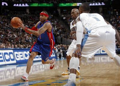 Detroit Pistons guard Allen Iverson (left) drives past Denver Nuggets guard Chauncey Billups (center) in January. Billups and Iverson swapped teams as part of a trade in November 2008. (AP Photo)