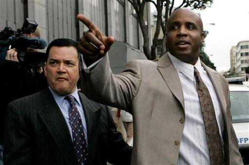 Former San Francisco Giants baseball player Barry Bonds (right) leaves a federal courthouse in January. Bonds is charged with lying to a federal grand jury in 2003 when he said he never knowingly used performance-enhancing drugs. (AP Photo)