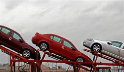 General Motor autos sit on the top of a car carrier at the General Motors Assembly Plant on Wednesday, Feb. 18, 2009 in Lordstown, Ohio. (AP)