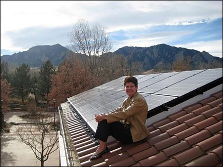 Val Peterson on top of the Chancellor's Residence at University of Colorado-Boulder, where the house has been retrofitted with solar panels as part of the Smart Grid project. (Photo courtesy Val Peterson)