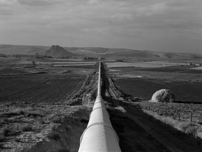 """(Lange) Lange's original caption: """"October 16, 1939. Malheur County, Oregon. Shows siphon, 5 miles long, 8 feet in diameter, which carries water to Dead Ox Flat. This is the world's longest siphon."""""""