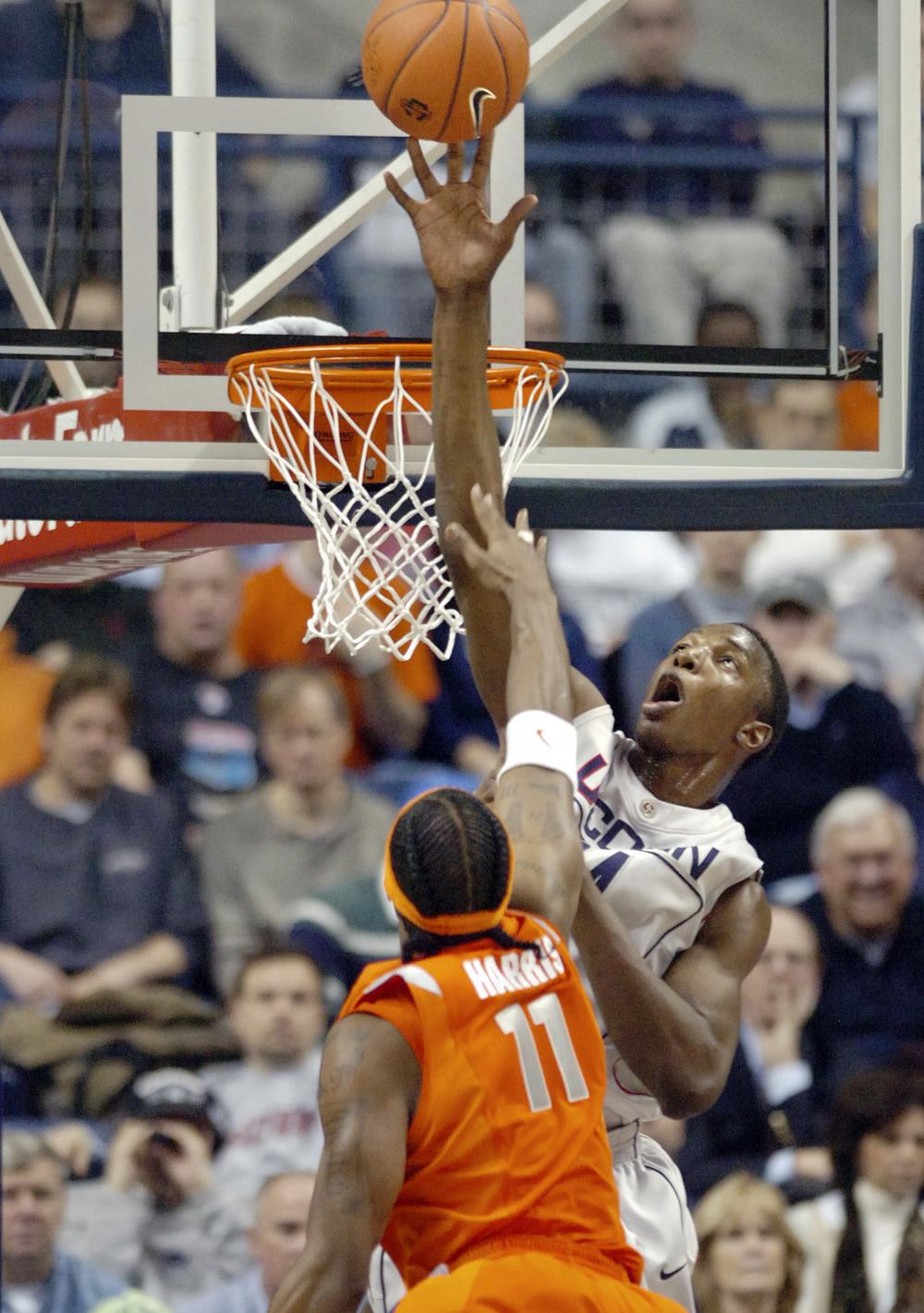 Connecticut's Hasheem Thabeet, right, blocks the shot of Syracuse's Paul Harris during the NCAA college basketball game in Conn., on Feb. 11, 2009. (AP)