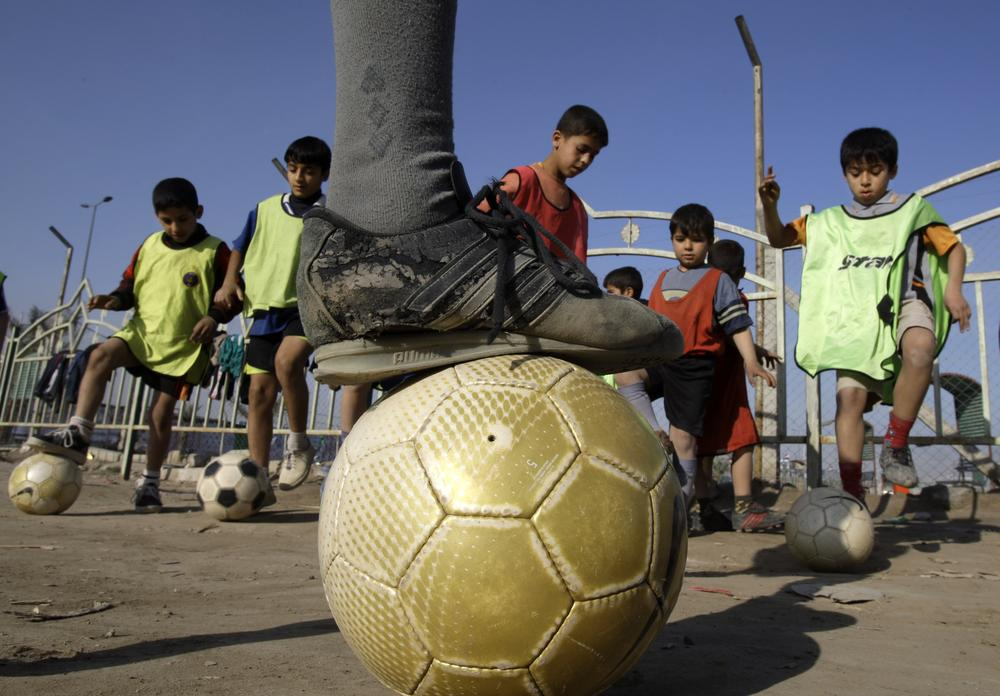 Children attend soccer practice in the Shiite neighborhood of Sadr City in Baghdad, Iraq, Jan. 25, 2009. (AP)