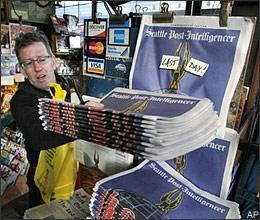 Final editions of the Seattle Post-Intelligencer at First & Pike News in downtown Seattle on Tuesday, March 17, 2009. The Tuesday edition ended a heritage stretching back nearly 146 years, when the Seattle Gazette, the P-I's predecessor, began publishing in December 1863. (AP)