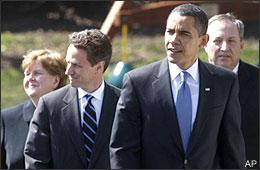President Barack Obama, accompanied by, from left, Economic Adviser Christina Romer, Treasury Secretary Timothy Geithner, and Economic Adviser Lawrence Summers, walks from the Oval Office to the South Lawn of the White House on March 18, 2009, to make remarks on AIG. (AP)