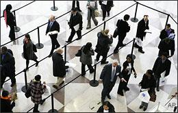 A line of job applicants snakes through a ropeline to attend the CUNY Big Apple Job Fair on Friday, March 20, 2009 in New York. (AP)