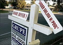 A house with a pool is advertised for under $80,000 in Stockton, Calif., on March 13, 2009. The National Association of Realtors said on Monday, March 23, that sales of existing homes rose from January to February in an unexpected boost for the slumping U.S housing market as buyers took advantage of deep discounts on foreclosures. (AP)