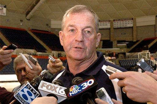 UConn men's basketball coach, Jim Calhuon, fields questions from reporters in 2008. His team has been in the spotlight this week, not because of their current run toward the Final Four, but because of alleged recruiting violations that surfaced on Wednesday. (AP Photo)