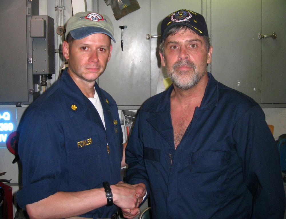 Maersk-Alabama Capt. Richard Phillips, right, shakes hands with Lt. Cmdr. David Fowler, executive officer of USS Bainbridge after being rescued by U.S Naval Forces off the coast of Somalia. (AP/ U.S. Navy)
