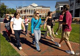 Prospective students follow a group tour through Elon University, on Oct. 13, 2008, in Elon, N.C. The high school class of 2009 will send the most ever graduates on to college next fall. But the souring economy and dramatic slump on Wall Street are providing a cold dose of financial reality for many families. (AP)