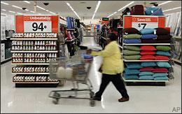 A shopper makes her way down an aisle at a Wal-Mart store in Indianapolis on April 9, 2009. (AP)