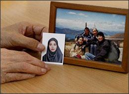 Akiko Saberi, mother of imprisoned Iranian-American journalist Roxana Saberi, holds her daughter's photo next to a family picture in Tehran, Iran, on Saturday, April, 25, 2009. The 31-year-old dual American-Iranian citizen was convicted of spying for the United States in Iran and sentenced to eight years in prison after a swift, closed door trial earlier this month. She has gone on a hunger strike to protest her imprisonment, her father said. (AP)
