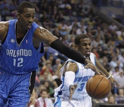 Dwight Howard (left) of the Orlando Magic and Chris Paul (right) of the New Orleans Hornets fight for a rebound during a game in New Orleans. Both players led their respective teams to the playoffs this year.