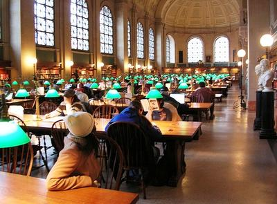 A reading room at the Boston Public Library. The library has seen a 30 percent increase in people getting new library cards since July. (adm/Flickr.)