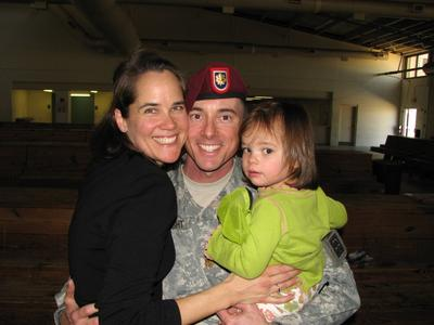 Kelly Wright, her husband, and their daughter, at his homecomeing from his latest deployment.