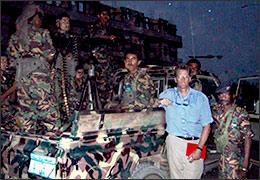 Neil MacFarquhar and bodyguards, Marib, Yemen.